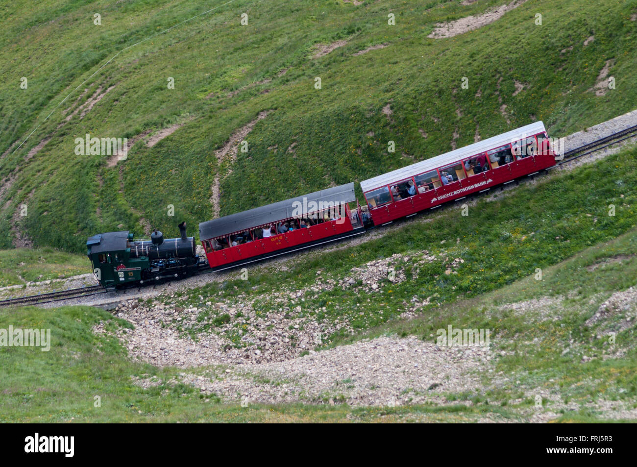 Steam train of the Brienz Rothorn Bahn rack railway below the summit (2252m). Brienz, Berner Oberland, Switzerland. - Stock Image