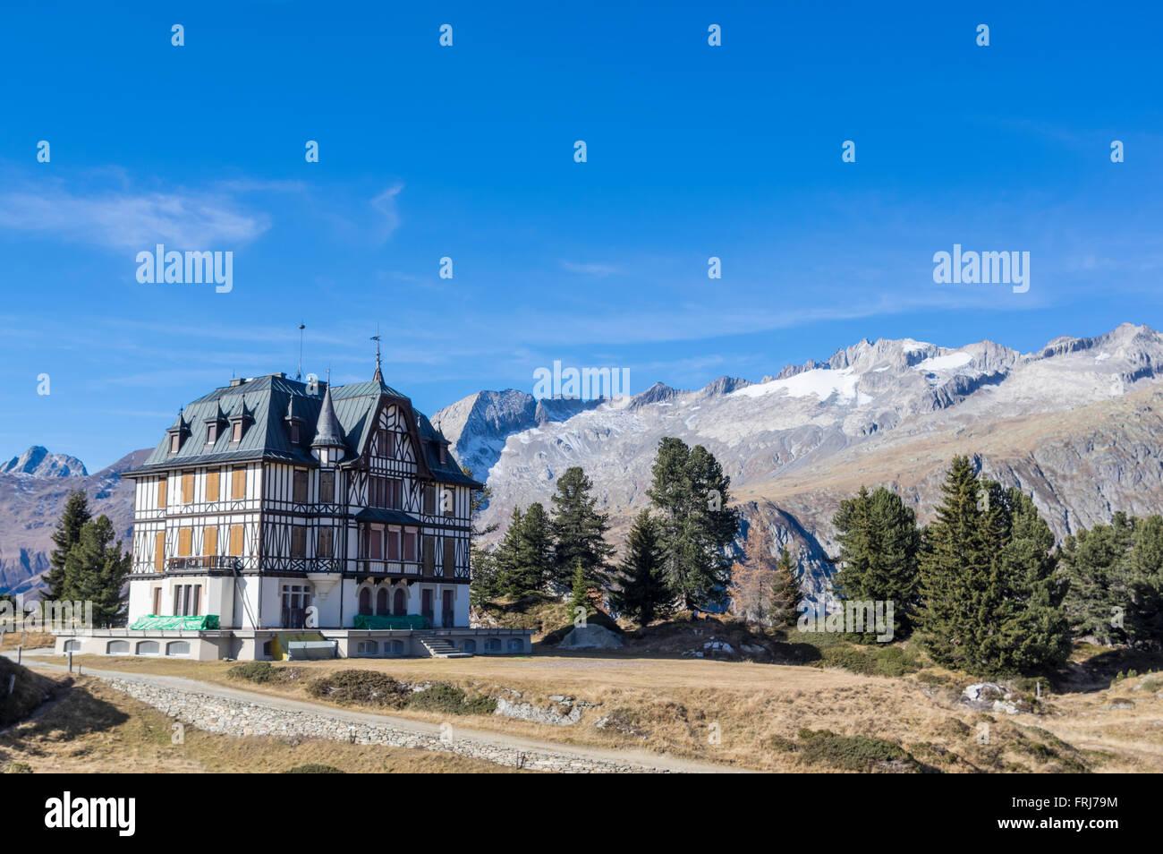 Villa Cassel, built 1899-1902 at Riederfurka, with a backdrop of mountains. Riederalp, Wallis/Valais, Switzerland. - Stock Image