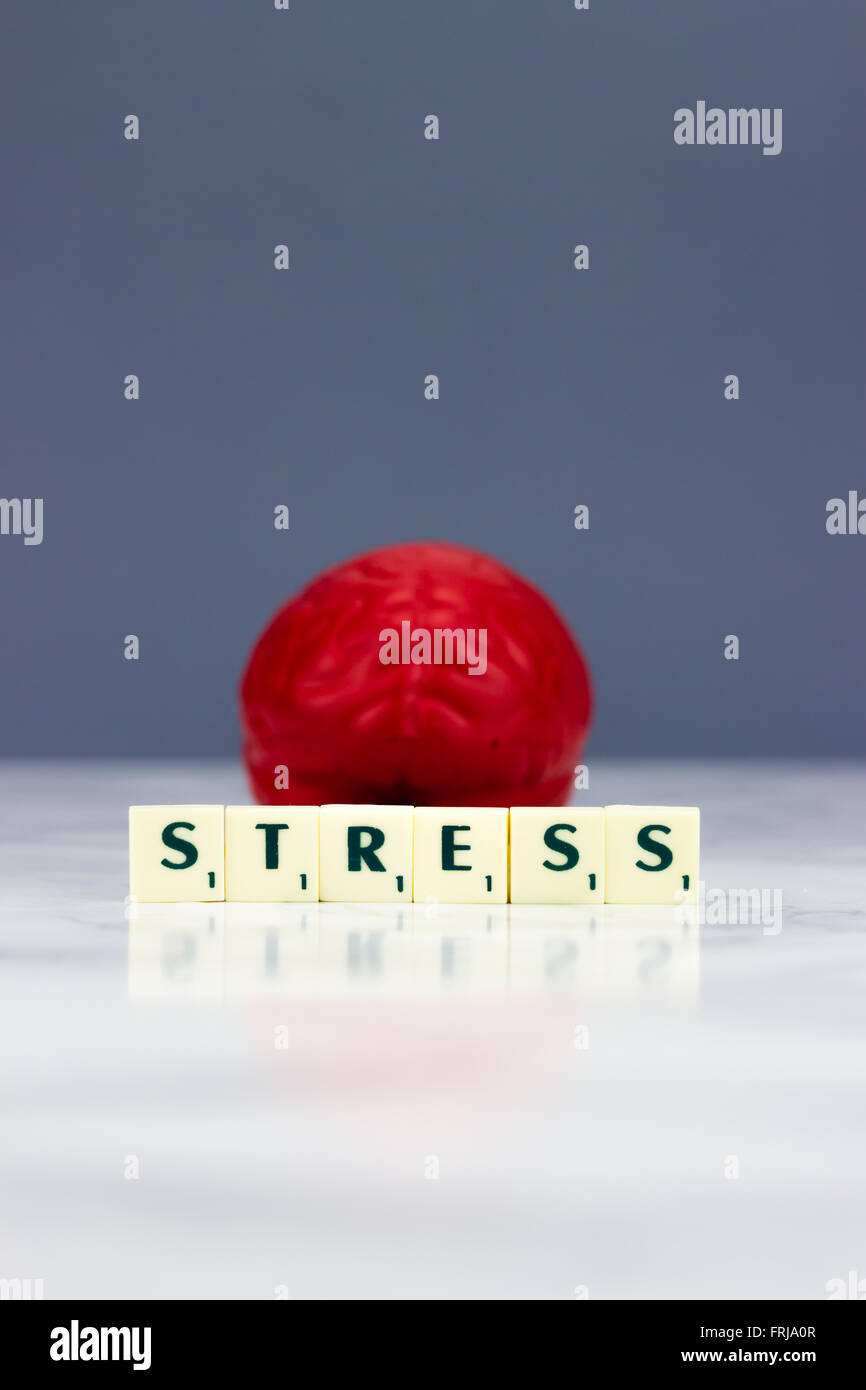 Red brain with stress sign dark background - Stock Image