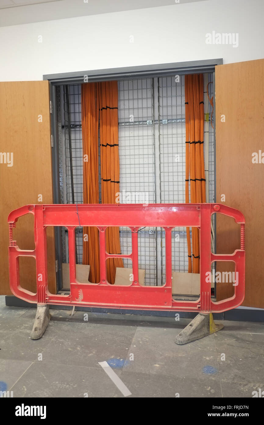 safety barriers across an open data or electrical riser cupboard