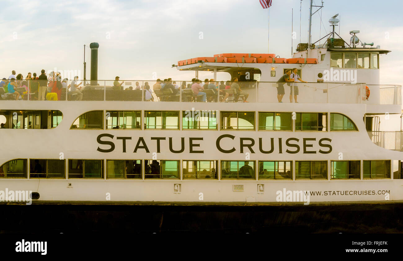 Statue Cruises tourist trips boat to Statue of Liberty, New York City, USA. - Stock Image