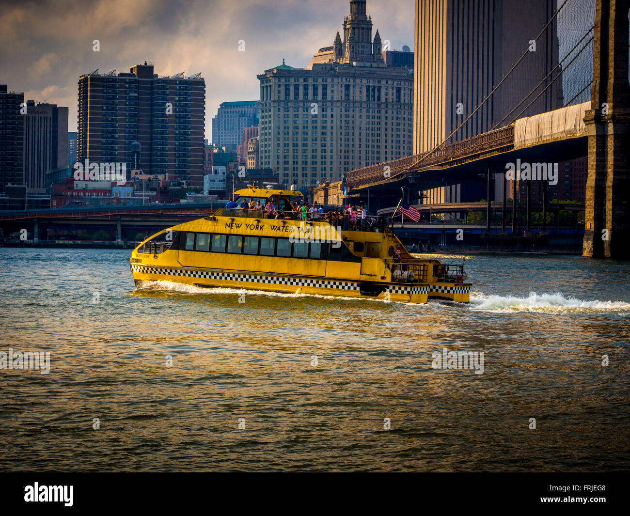New York Water Taxi with Brooklyn Bridge on the East river, New York, USA - Stock Image
