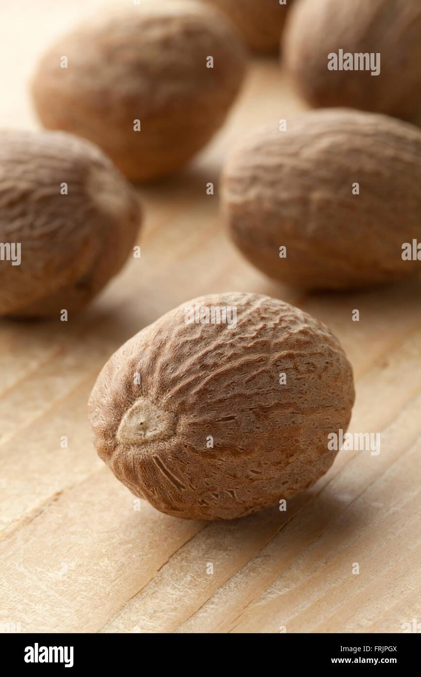 Single nutmeg kernel close up - Stock Image
