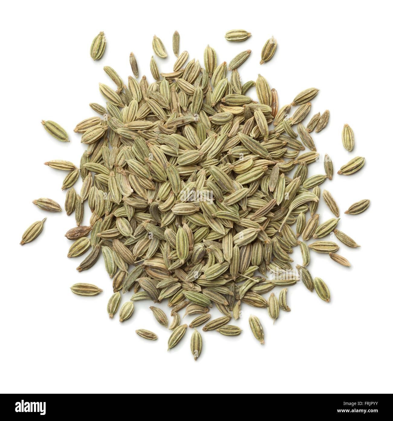 Heap of green fennel seeds on white background - Stock Image