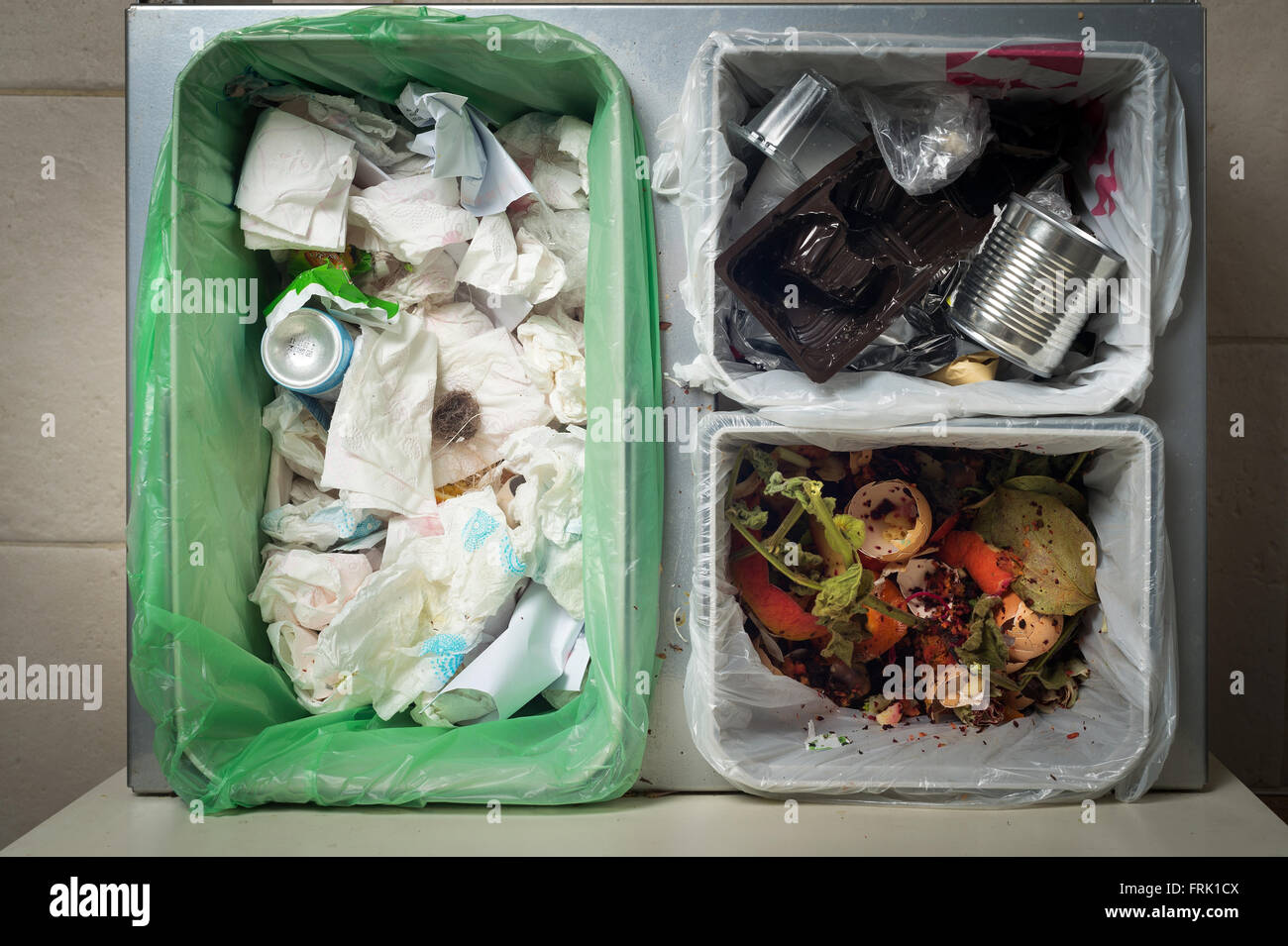 Household waste sorting and recycling kitchen bins in the drawer. Environmentally responsible behavior concept, Stock Photo