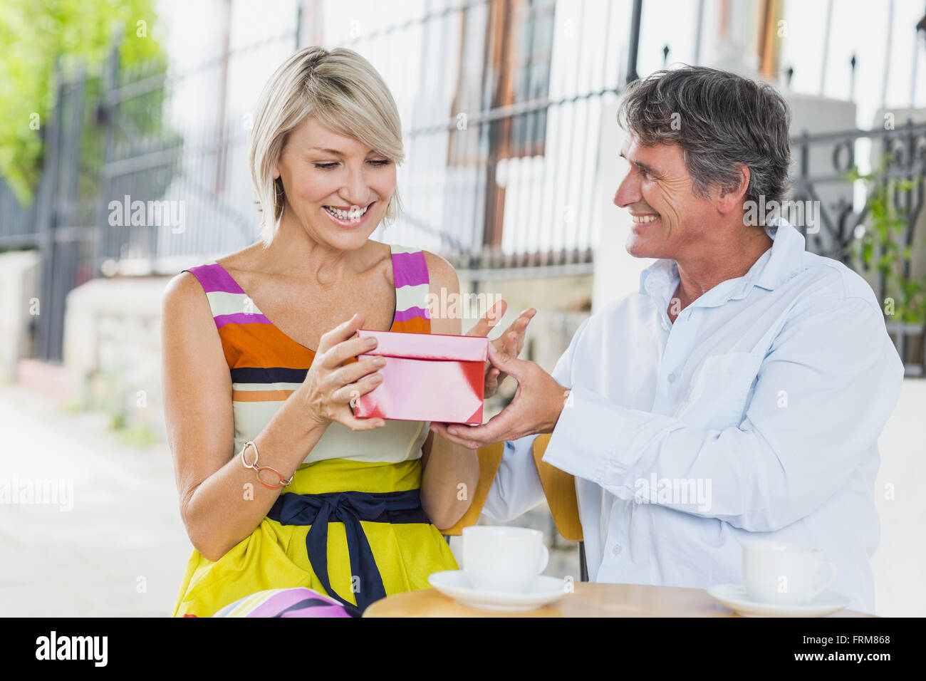 Woman receiving gift from man Stock Photo