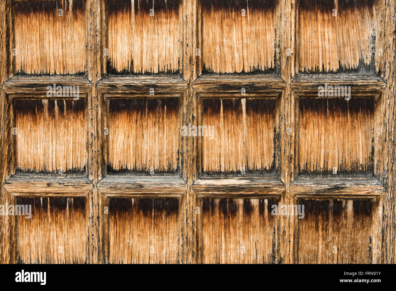 Old grunge wood background with square applications Stock Photo