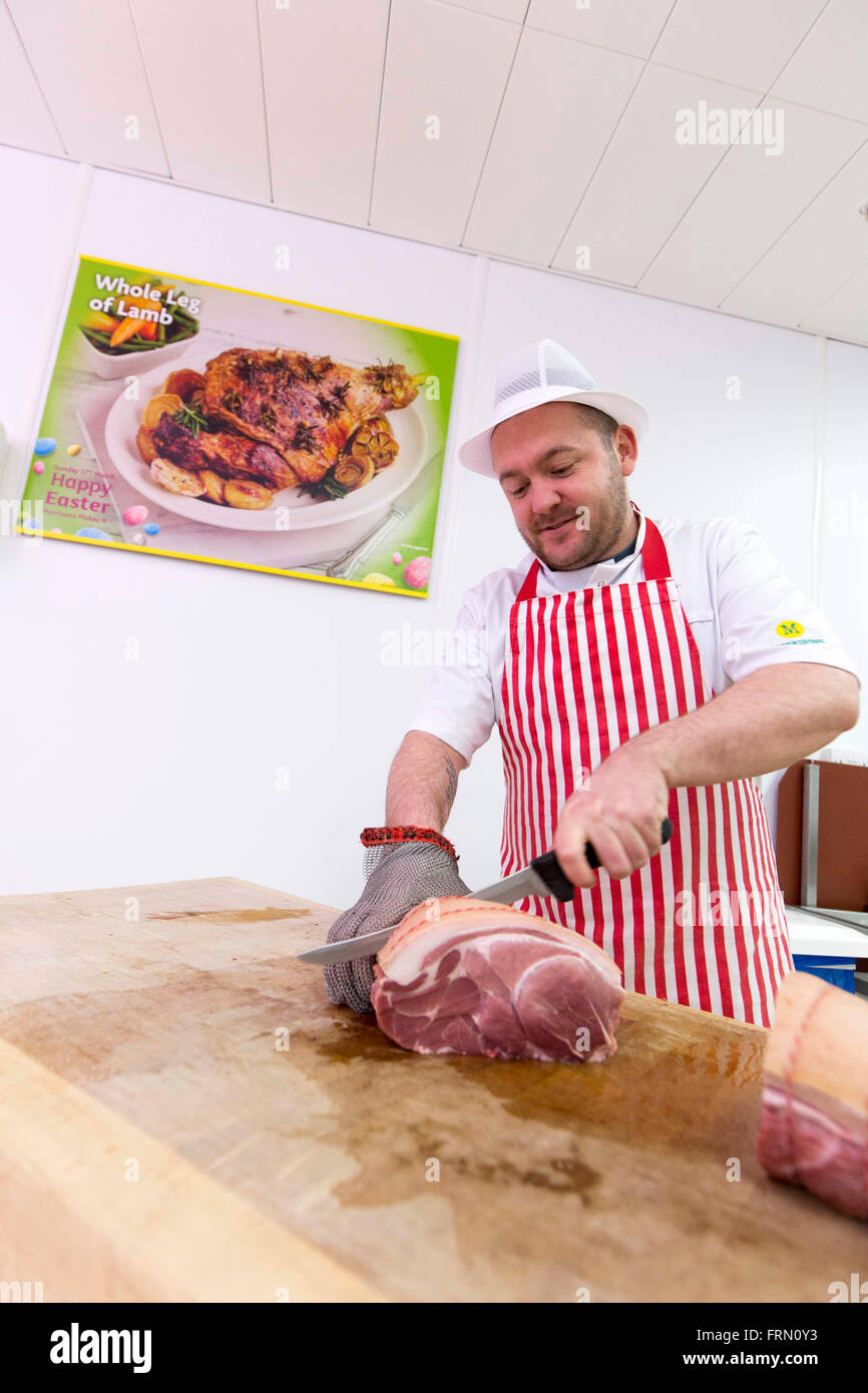 A butcher at a Morrisons fresh look store Stock Photo