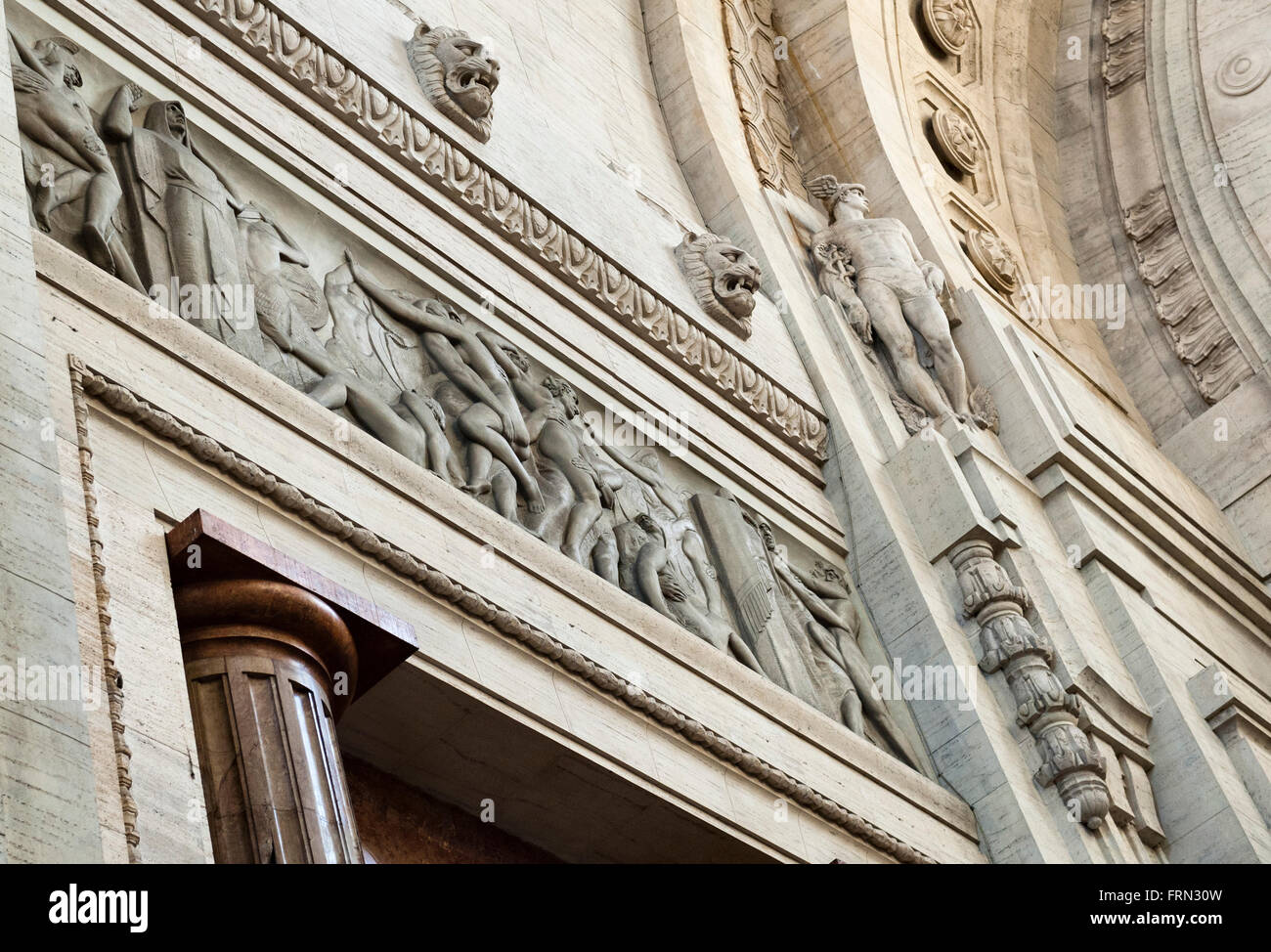 Milan railway station (Milano Centrale), Italy, completed in 1931. A frieze showing an episode from Roman history - Stock Image