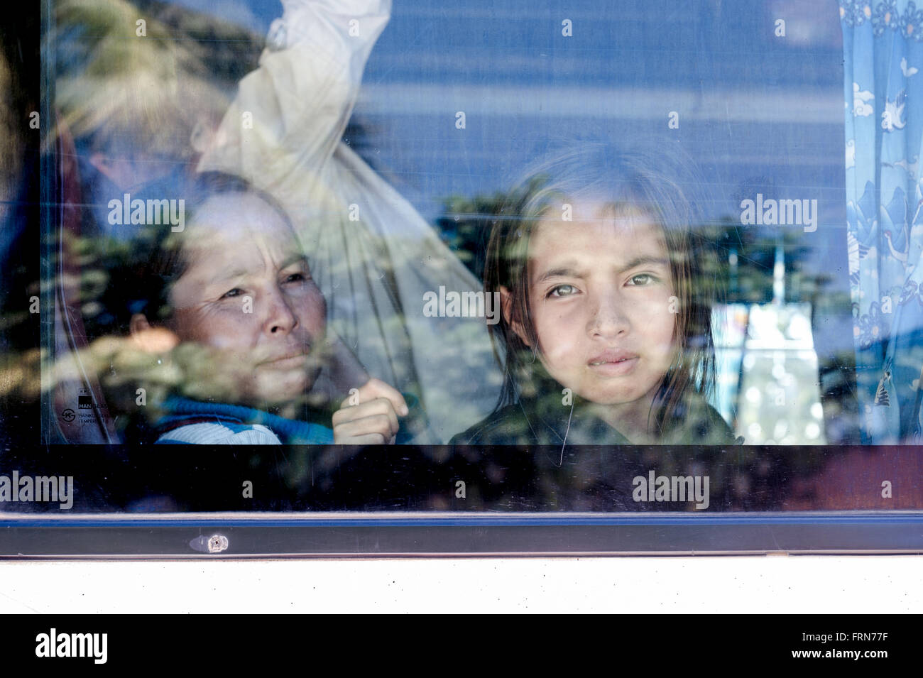 Asia. South-East Asia. Laos. Portrait of a little girl in a public bus. - Stock Image