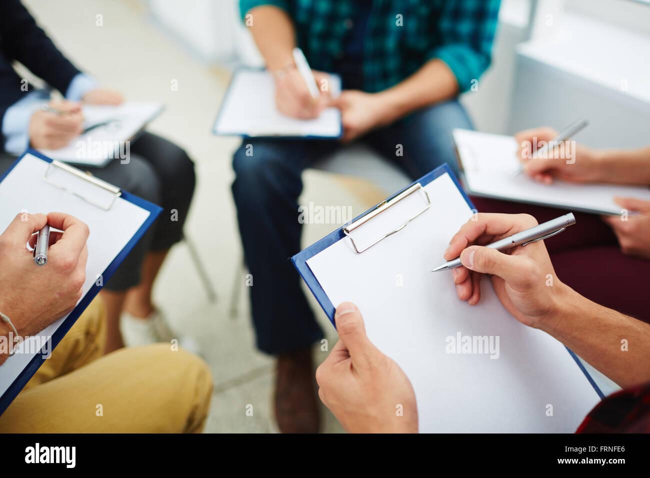 Writing down ideas - Stock Image