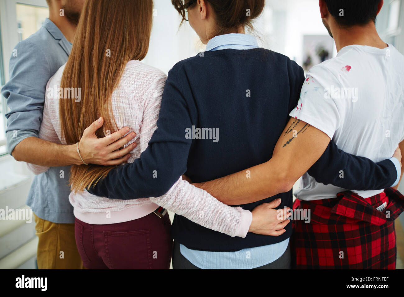 Embrace of groupmates - Stock Image
