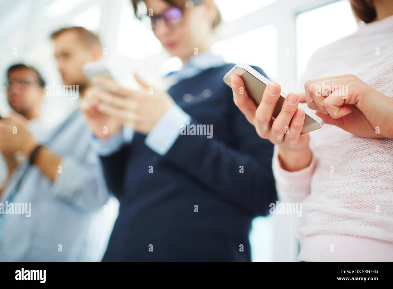 Using cellphones - Stock Image