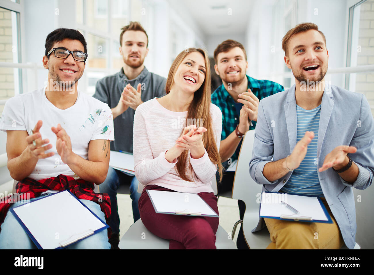 Applauding after lecture - Stock Image
