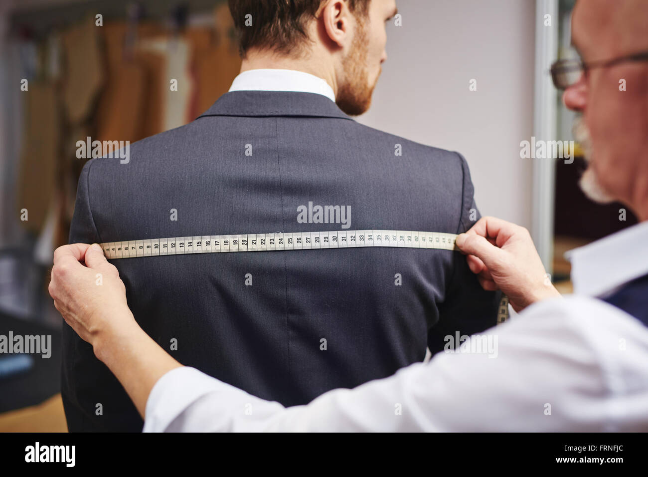 Measuring back of jacket - Stock Image