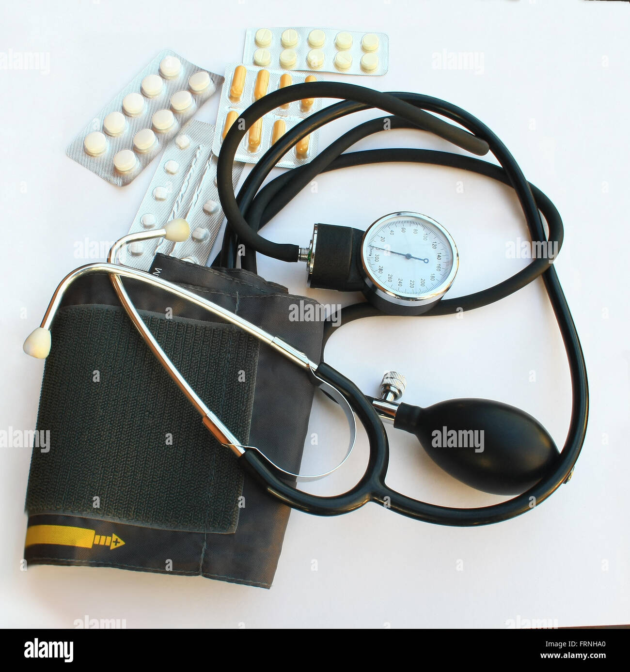 blood pressure meter and pills medical theme - Stock Image