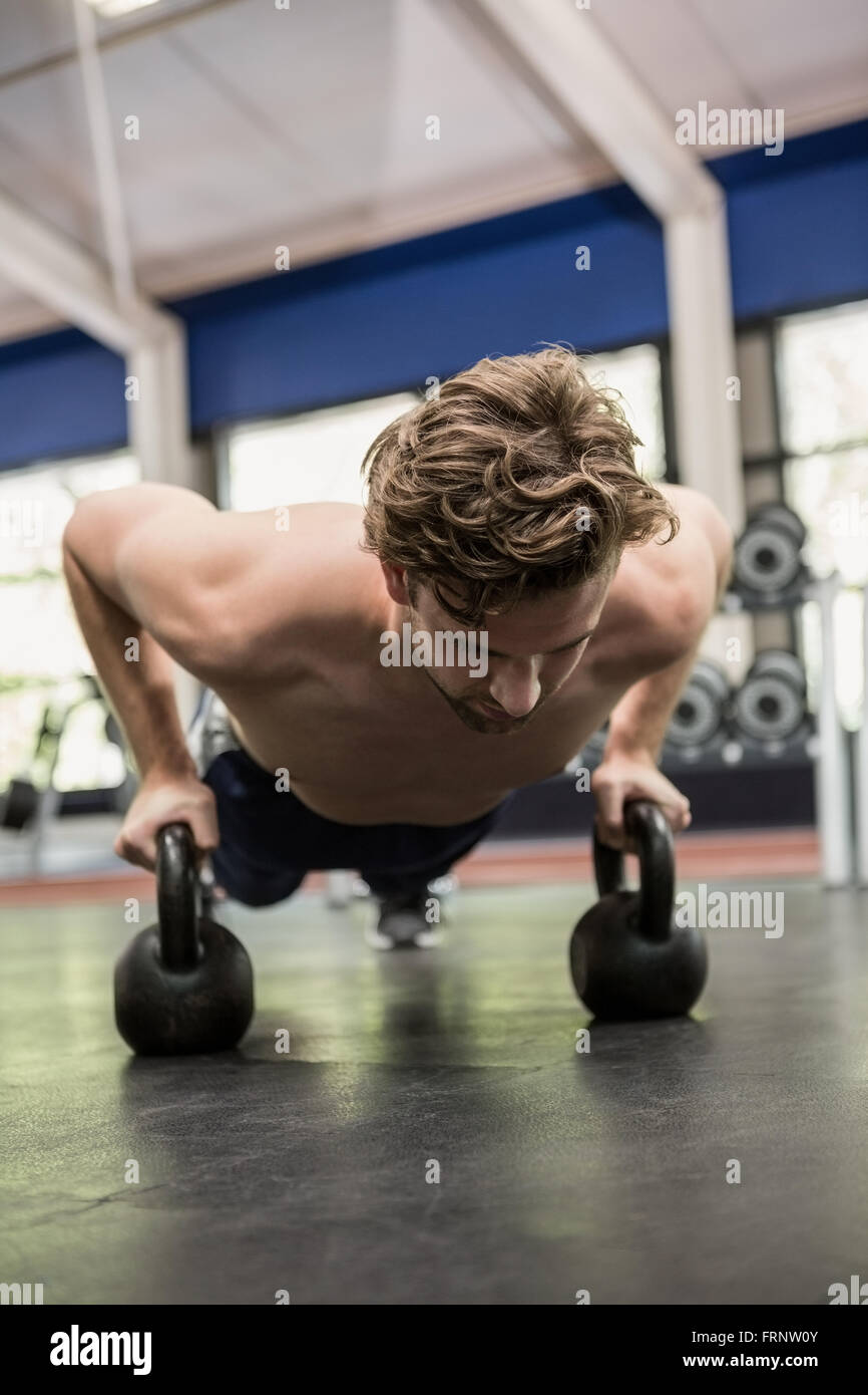 Man working out with kettlebell - Stock Image