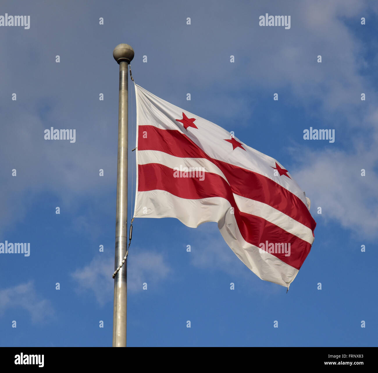 Flag of the District of Columbia flying from a flagpole in Washington. Stock Photo