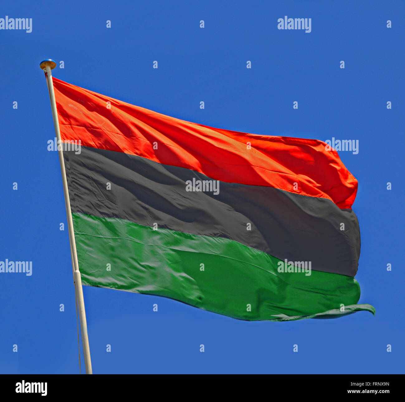 Libyan Flag fluttering in a brisk breeze. - Stock Image