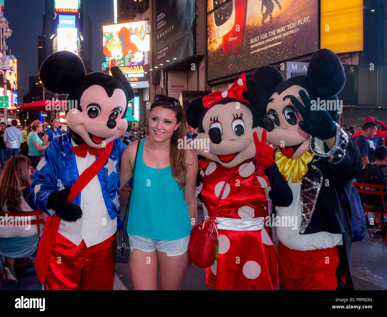 Female Ourist With Mickey And Minnie Mouse Characters Times Square At Night New York