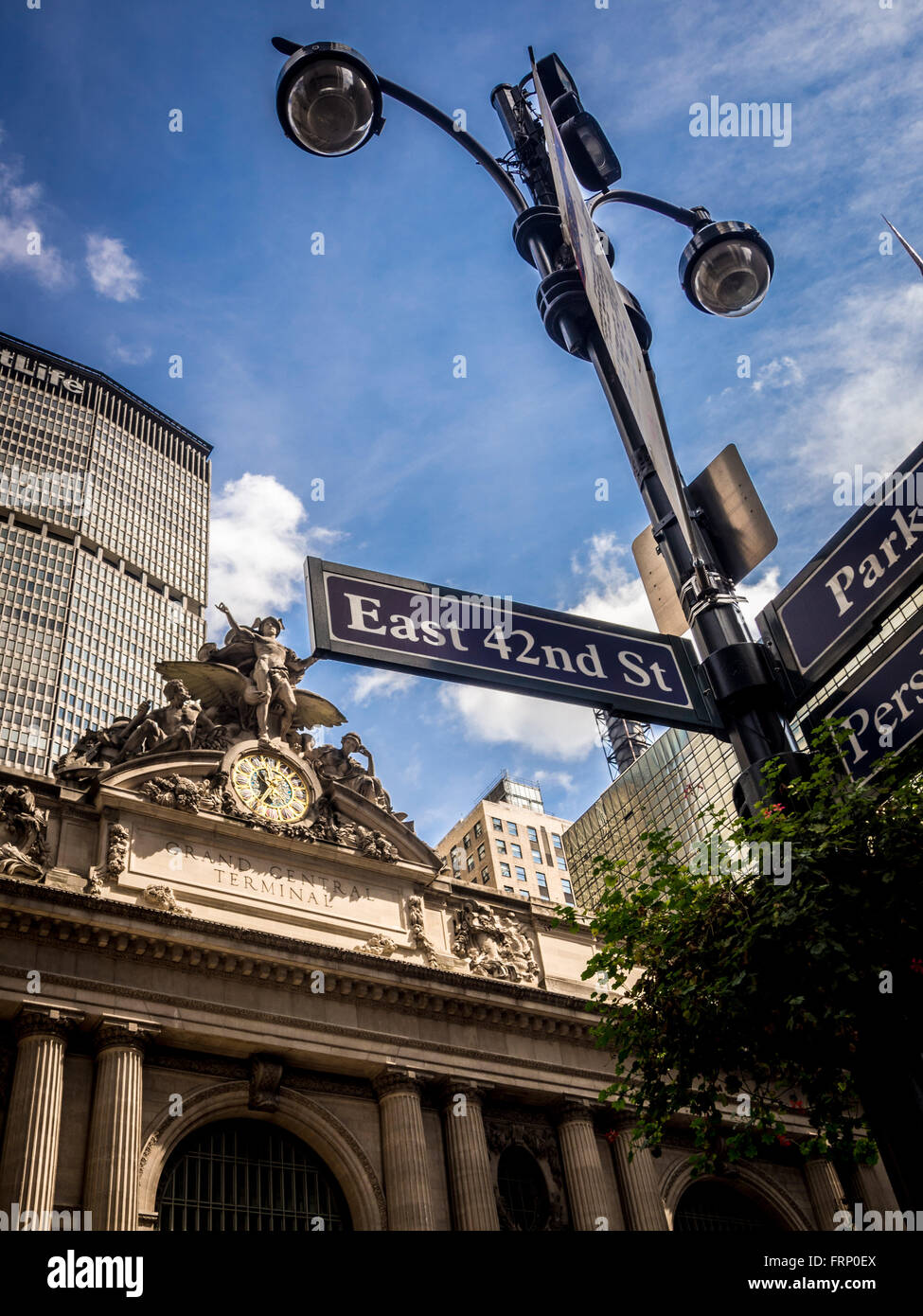 East 42nd St sign on lampost outside Grand Central Terminal train station, New York City, USA. - Stock Image