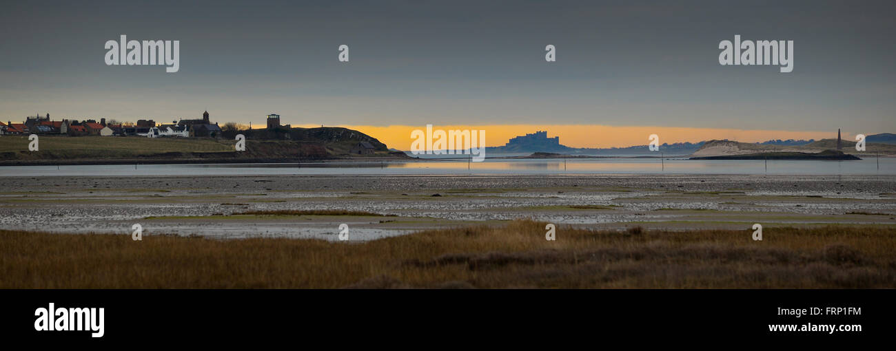 Bamburgh Castle on the north east coast of Northumberland. Once the residence of the Kings of Northumbria from Holy - Stock Image