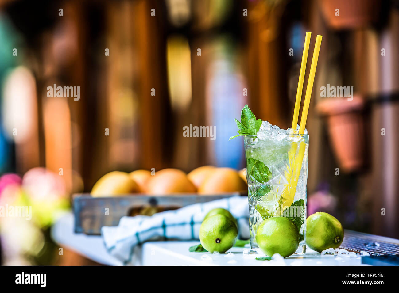 Mojito. Mojito cocktail. Cocktail glass on the bar counter outdoors. Alcoholic drink. - Stock Image