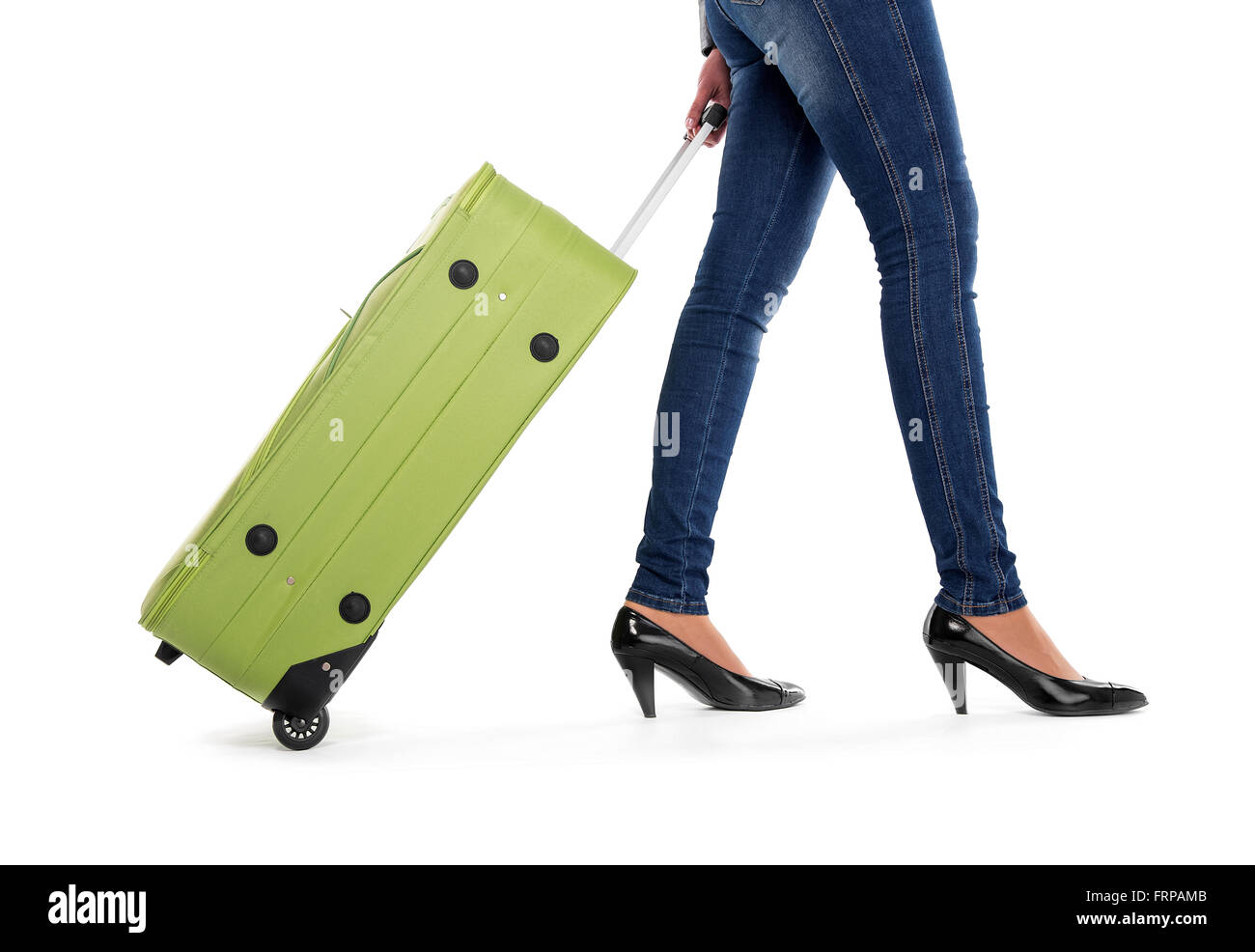 Woman with green suitcase. - Stock Image