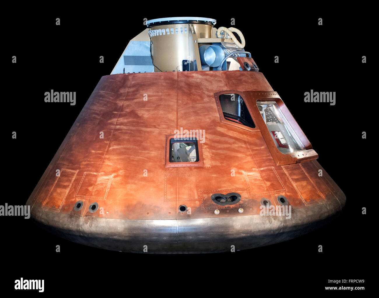 Side view of single Apollo rocket module on display over black background on display in museum - Stock Image