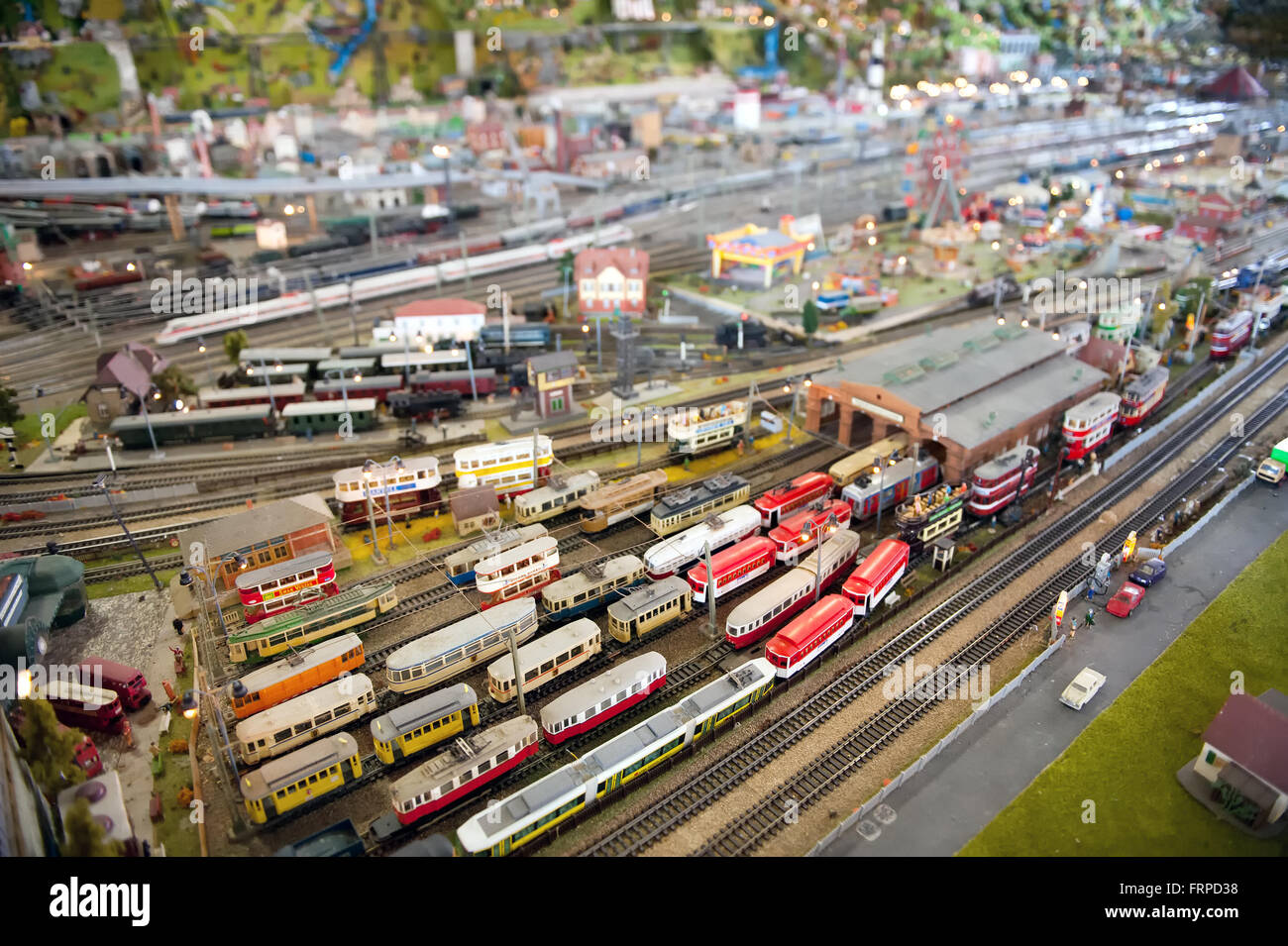 Miniature model of a railway terminal and station in a modern city with rolling stock, passengers and cars Stock Photo