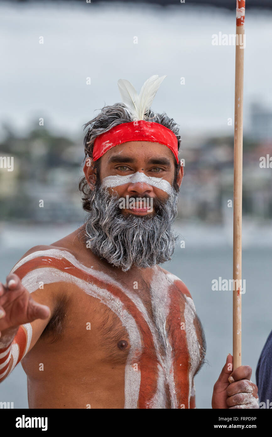 aboriginal australian dancer with painted face and body holding a