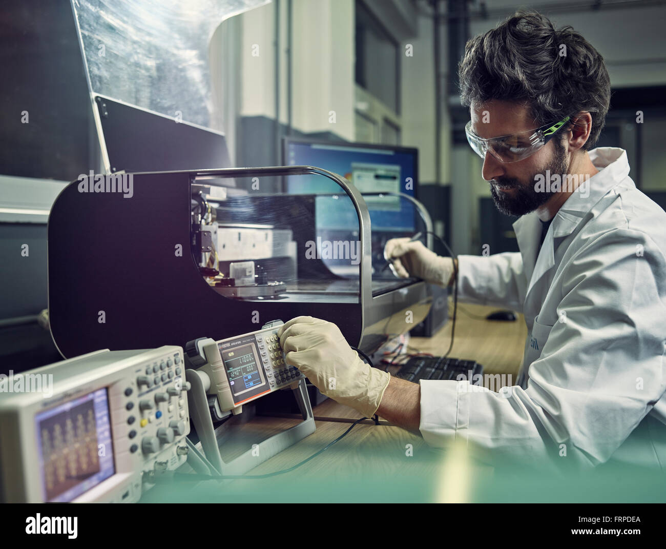 Worker, instrument technician measuring resistance, electrical signals, Austria - Stock Image