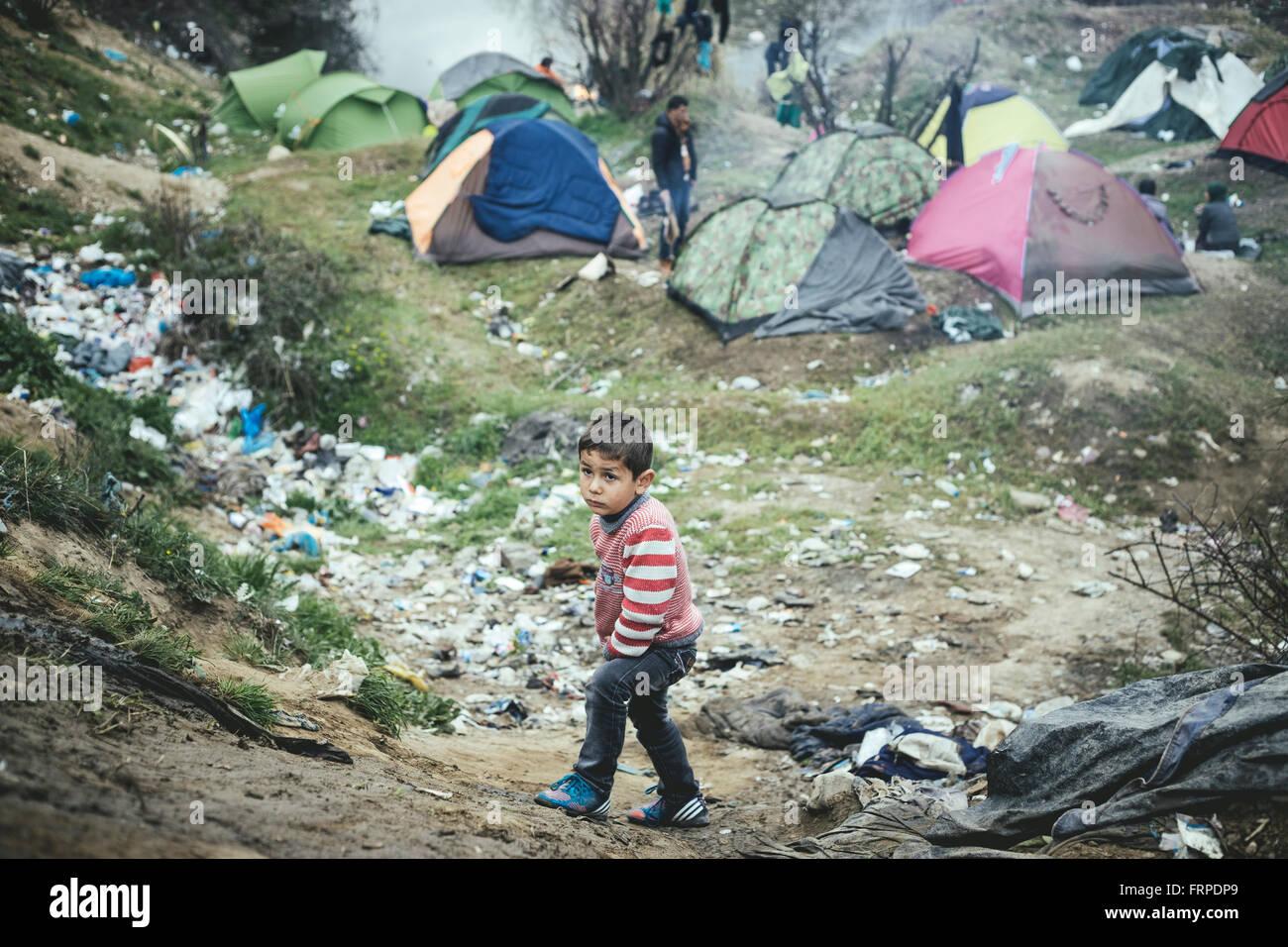 Idomeni refugee camp on Greek Macedonia border, desperate little boy, Idomeni, Central Macedonia, Greece - Stock Image