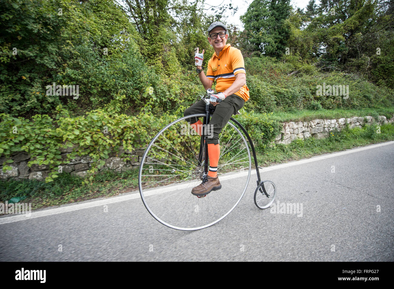 A velocipede, the ancestor of the bicycle, at the race. Eroica is a cycling event that takes place since 1997 in - Stock Image
