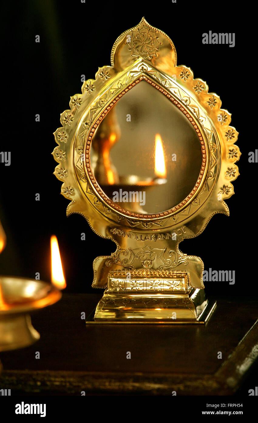 Aranmula kannadi ( Aranmula mirror) is a handmade metal-alloy mirror, made in Aranmula,India. Geographical Indications - Stock Image