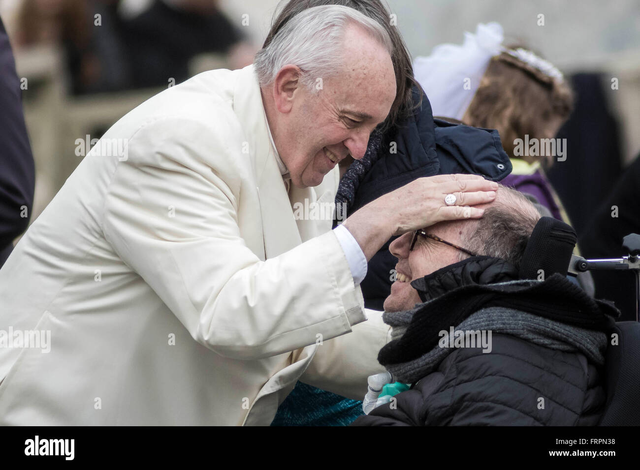 Vatican City, Vatican. 23rd Mar, 2016. Pope Francis blesses sick people during his Weekly General Audience in St. - Stock Image