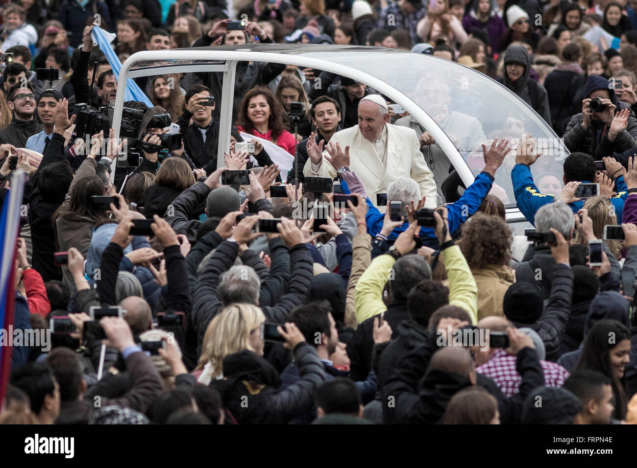 Vatican City, Vatican. 23rd Mar, 2016. Pope Francis rides through the crowds of the faithful as he holds his Weekly - Stock Image