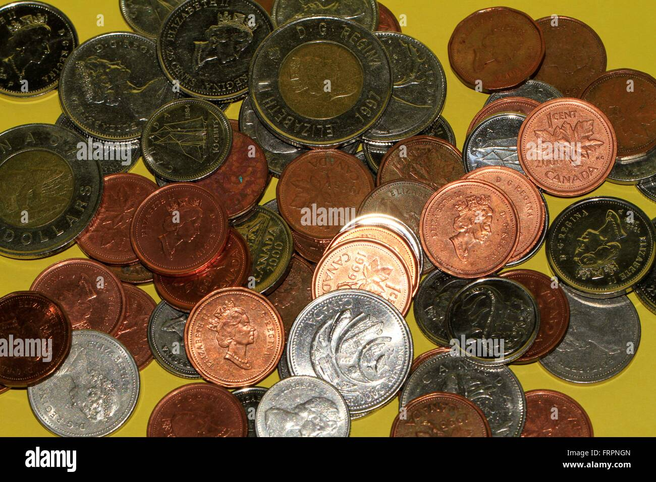 Dollar coins and US dollars in bills. The cent is the hundredth part of a dollar. The dollar is the currency in - Stock Image