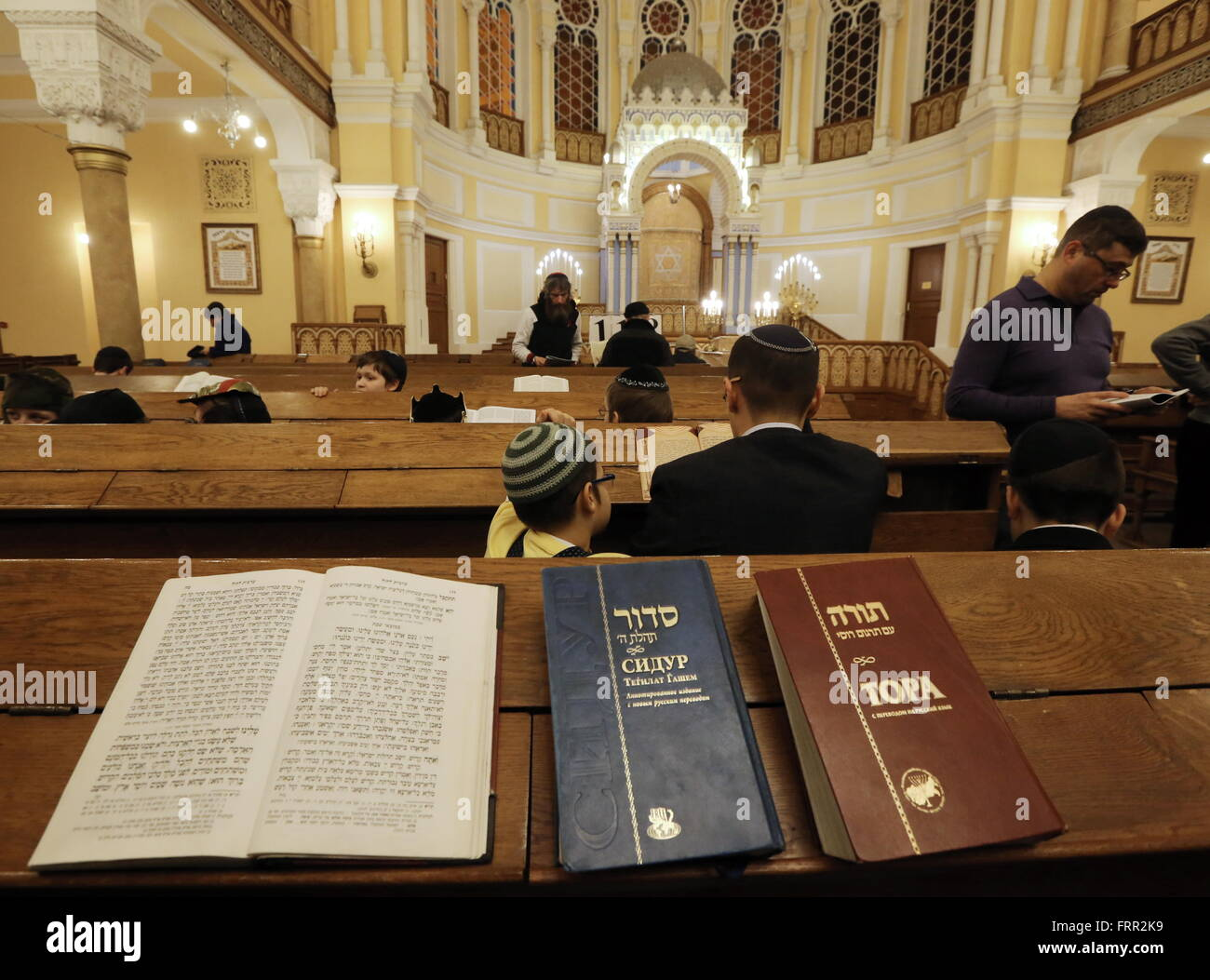 ST PETERSBURG, RUSSIA. MARCH 23, 2016. Jews reading during the festival of Purim at St Petersburg's Grand Choral - Stock Image