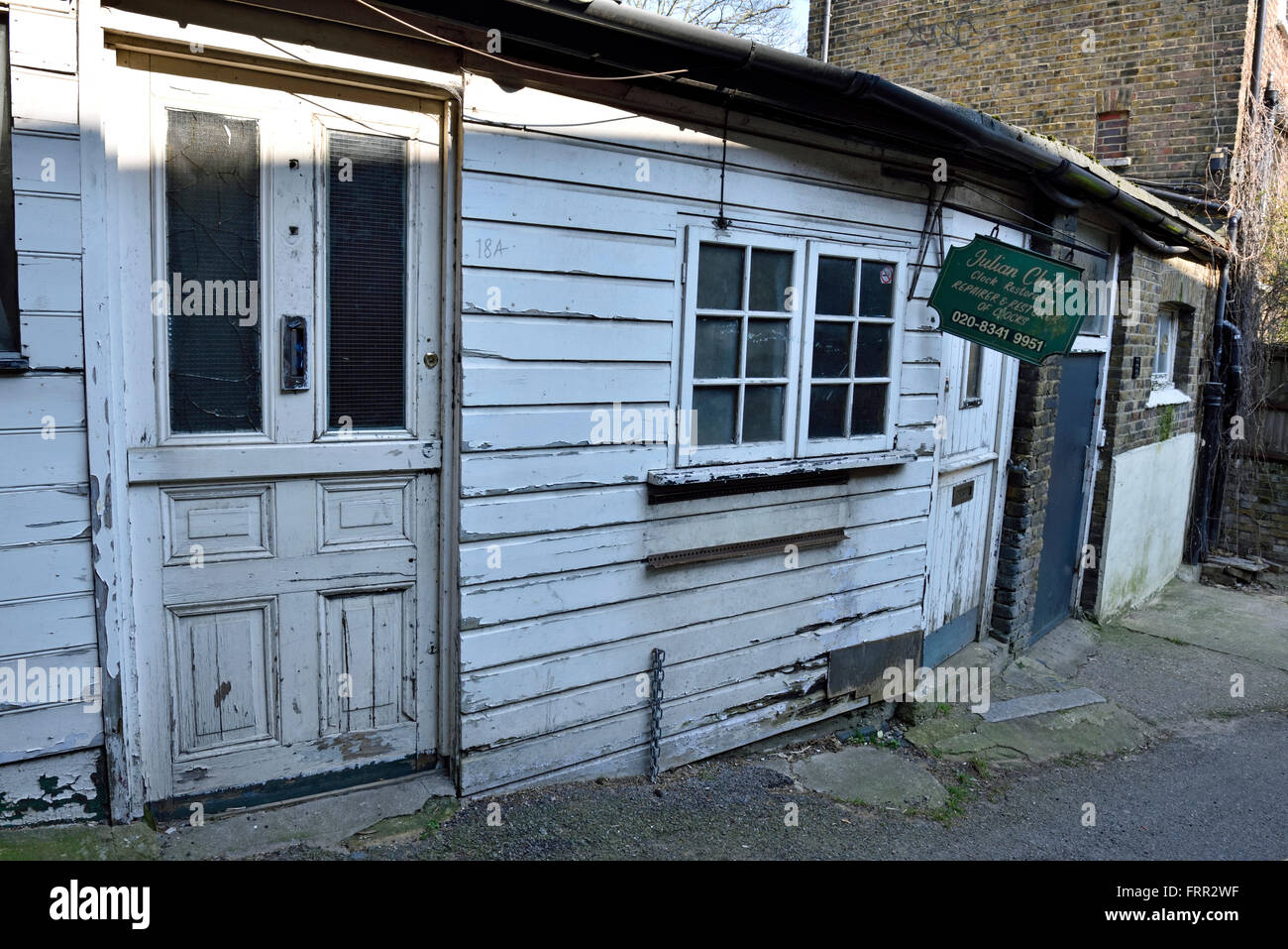 Derelict wooden single story white painted work building, Highgate Village London Engalnd Britain UK - Stock Image