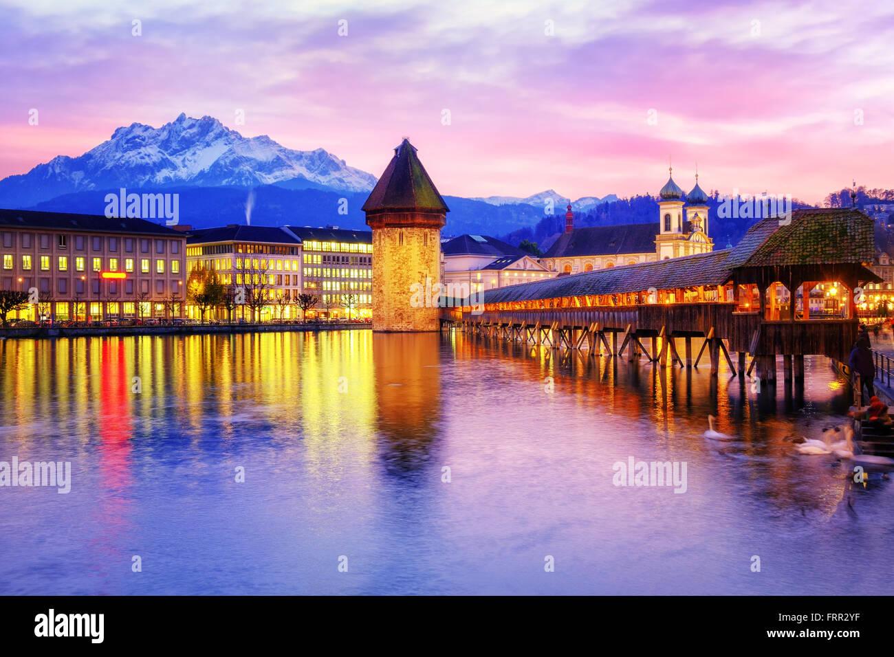 Chapel bridge, Water tower and Mount Pilatus on sunset, Lucerne, Switzerland. - Stock Image