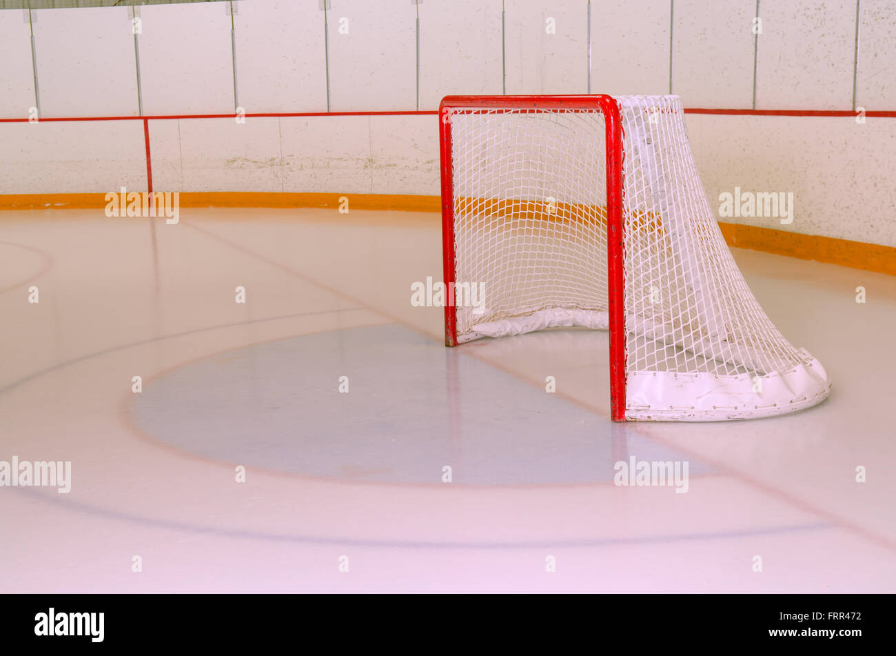 A Typical Hockey or Ringette Arena Net in the Crease of Hockey Rink - Stock Image