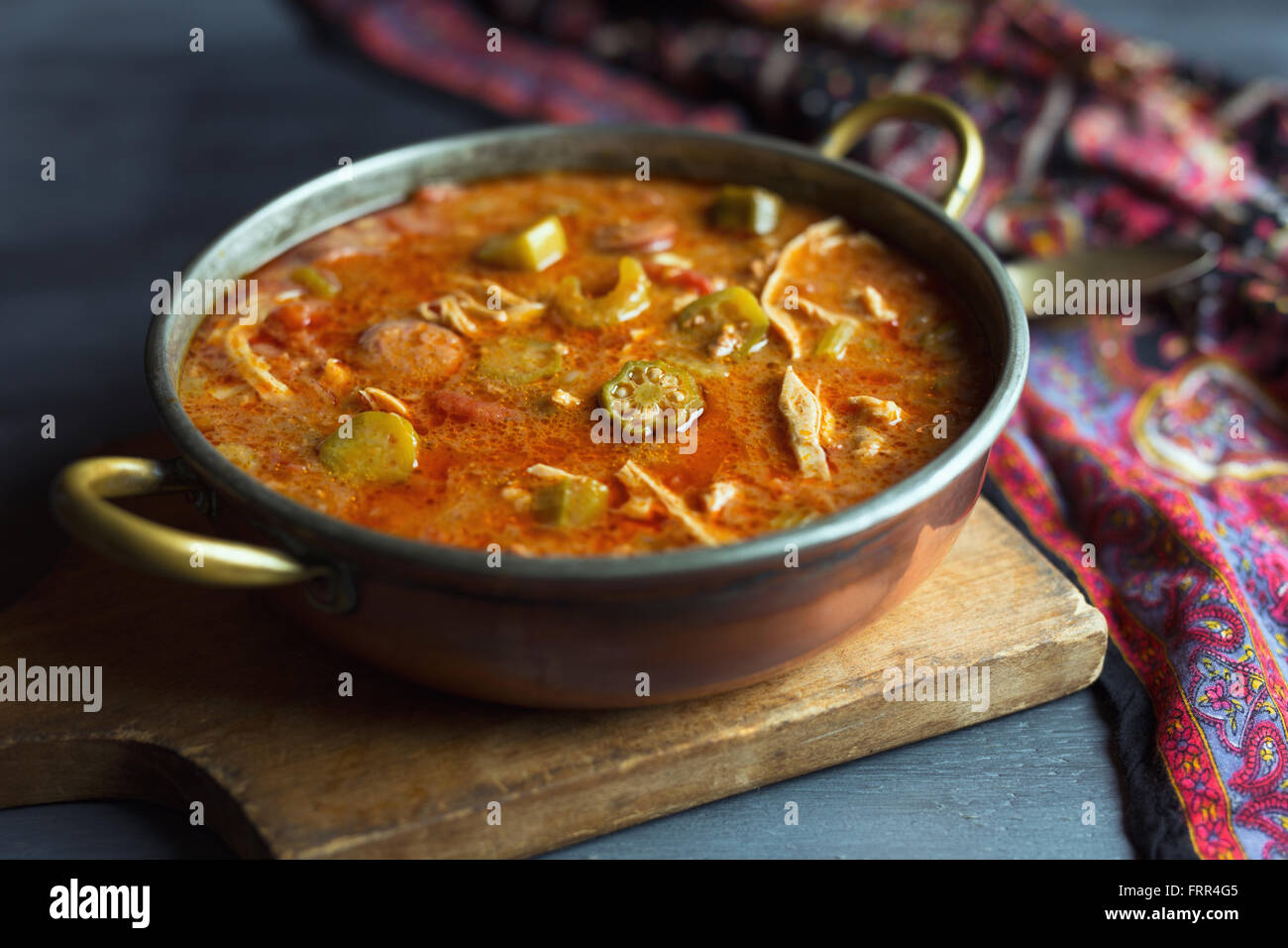 Copper pot filled with chicken and sausage gumbo. - Stock Image