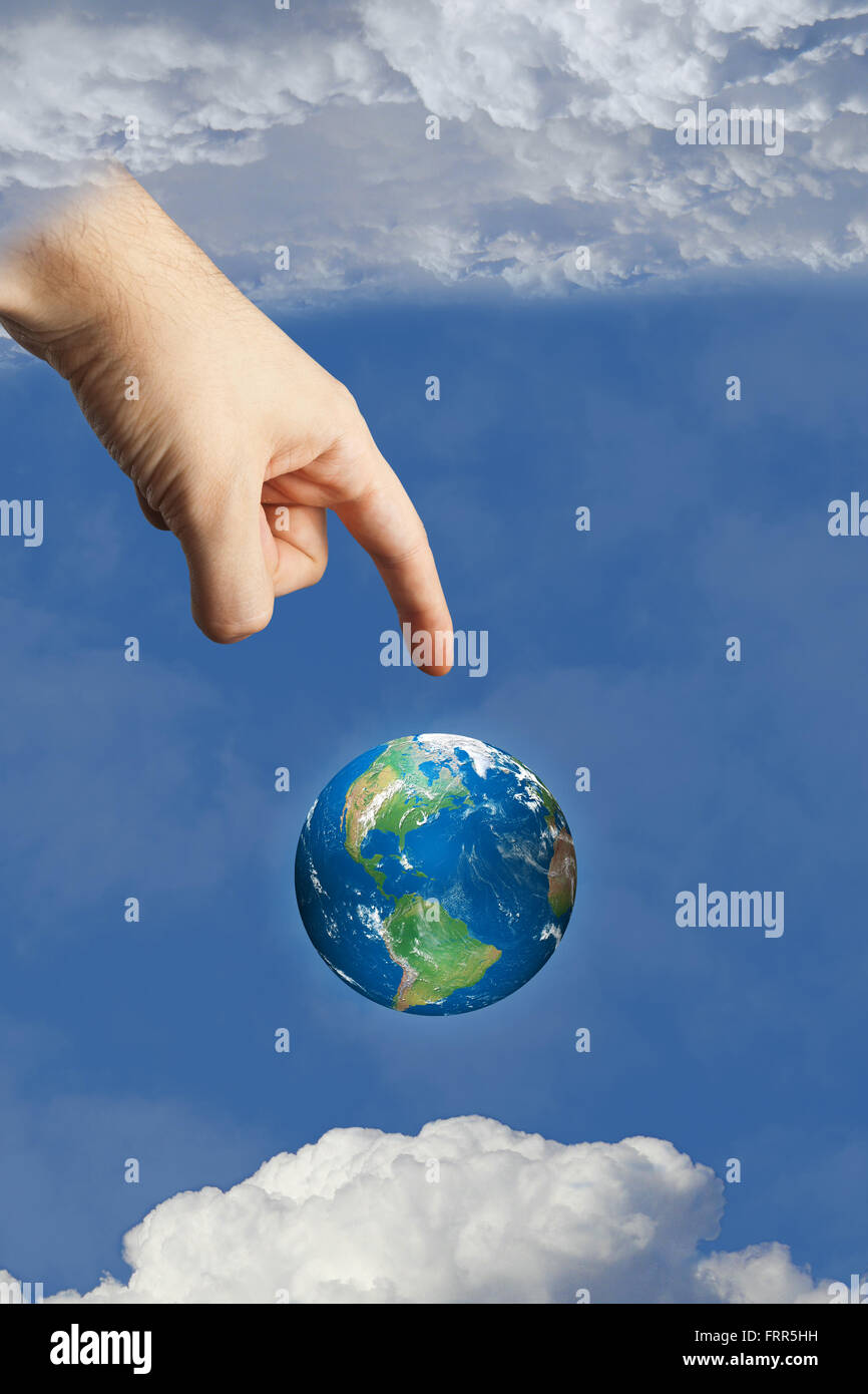 god's hand touching earth in heaven in the sky between the clouds, symbolizing faith and religion. images used - Stock Image