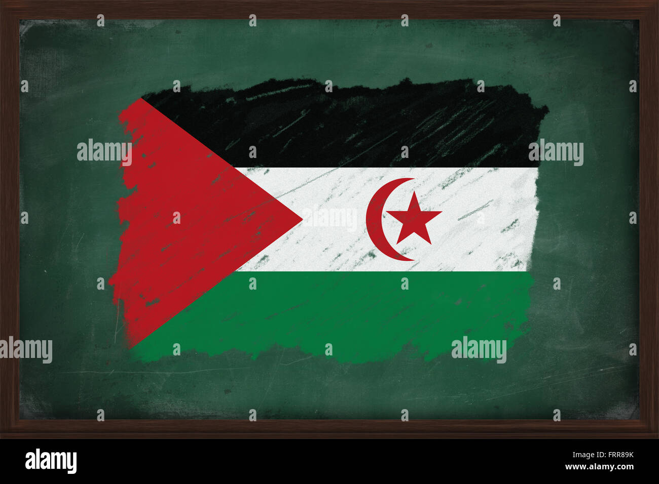 Sahrawi Arab Democratic Republic flag painted with color chalk on old blackboard - Stock Image