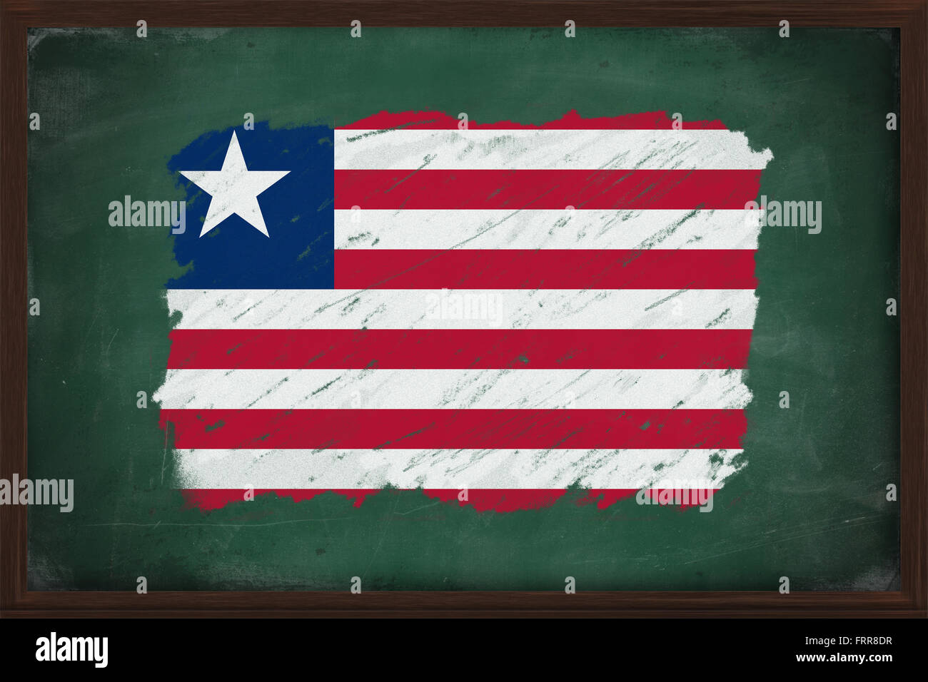 Liberia flag painted with color chalk on old blackboard - Stock Image