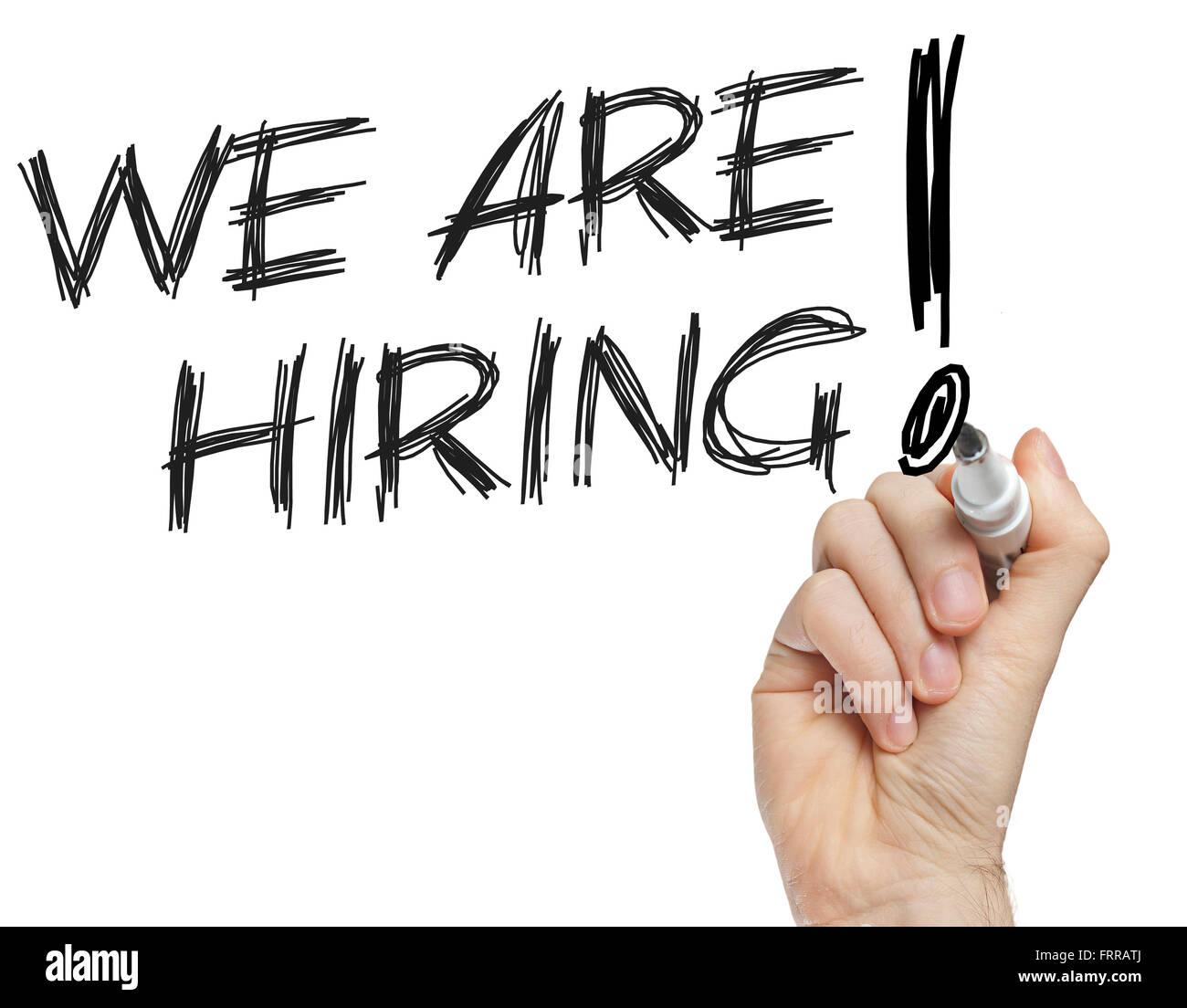We're hiring advertisement written on whiteboard - Stock Image