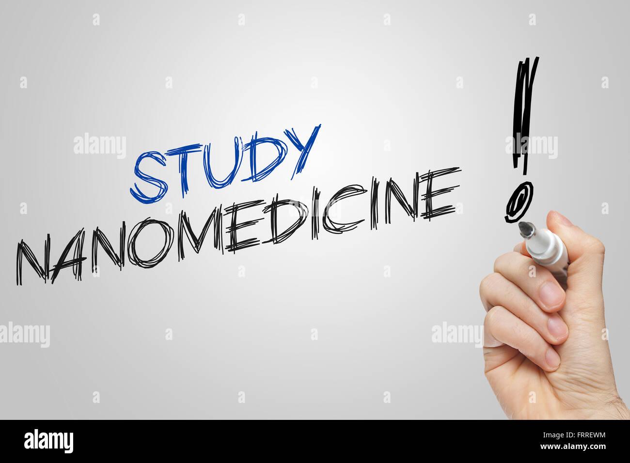 Hand writing study nanomedicine on grey background - Stock Image