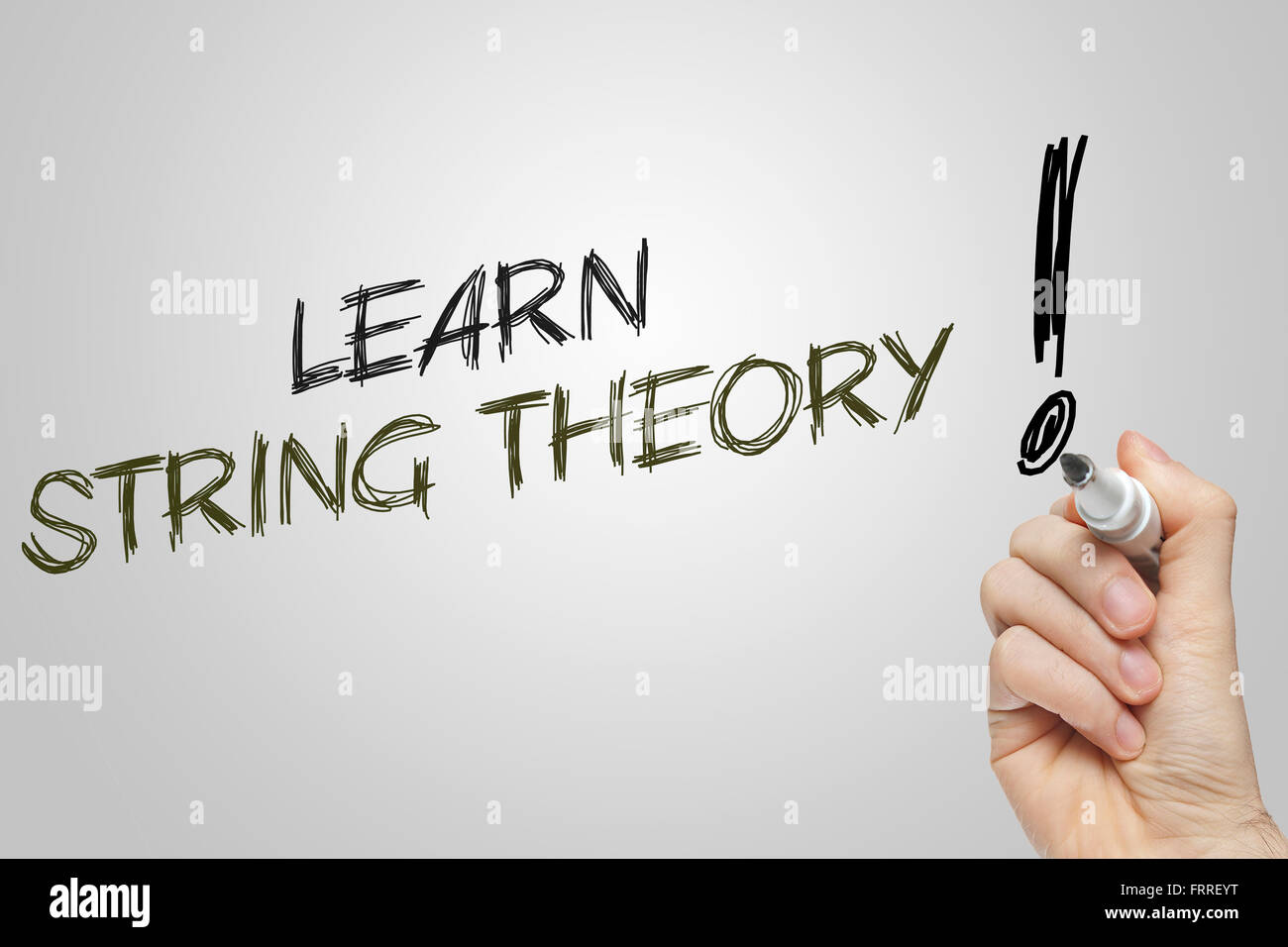 Hand writing learn string theory on grey background - Stock Image