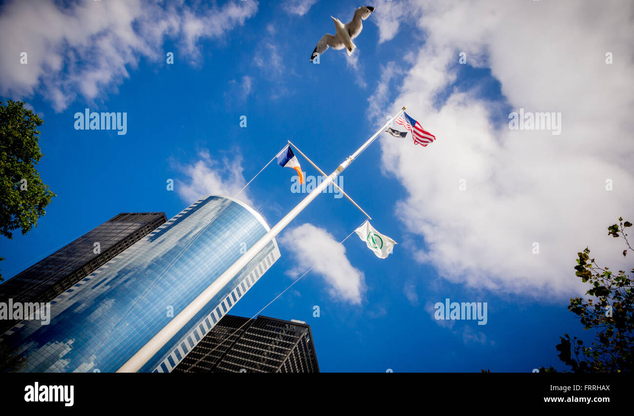 Flagpole outside United States Coast Guard building, New York City, USA. with Stars and Stripes Flag and New York - Stock Image